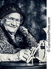 pearl beads - Portrait of a beautiful old lady in an elegant...