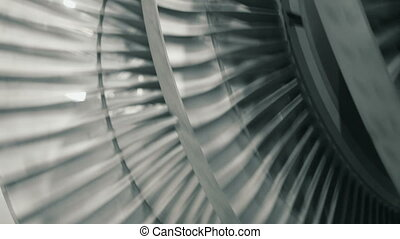close up of spinning steam turbine - closeup of rotating...