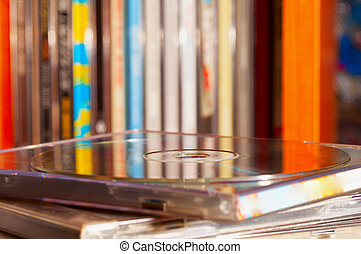 Cd in close up with other cds in the background