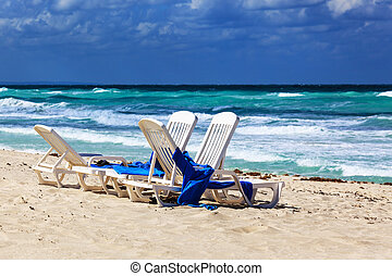 a chaise longue - chaise longue on a beach on a background...