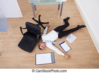 Businessman Fallen From Office Chair