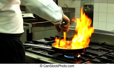 flame in a pan cook preparing food