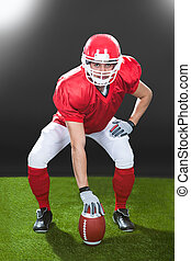 Confident American Football Snapper On Field - Full length...
