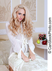 The beautiful girl on a bed - The beautiful blonde girl on a...