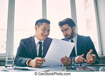 Discussion of contract - Two managers discussing contract in...