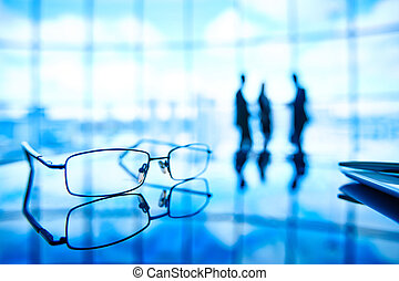 Eyeglasses - Image of eyeglasses at workplace and its...