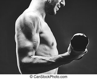 Man with barbell - Close-up of young guy with bare torso...