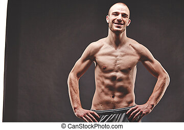 Muscular guy - Image of topless muscular man posing in the...