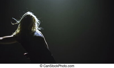 Perfect performance - Blond long-haired female performing...
