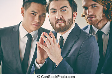 Wicked businessman - Bearded businessman with evil...