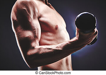 Sports activity - Close-up of sporty man with bare torso...