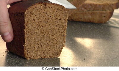 rye-bread cutting - the close-up of rye-bread cutting...