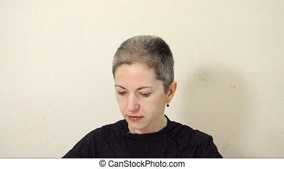 Shaving head - Female shaving her head bald