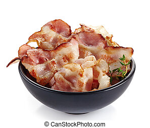 fried bacon strips in a bowl