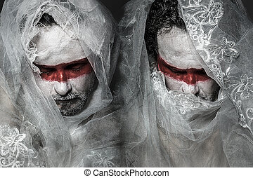 man covered with white lace veil, mask of red makeup