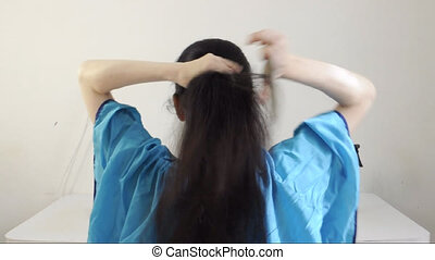 Cutting long hair off - Female model with long black hair...
