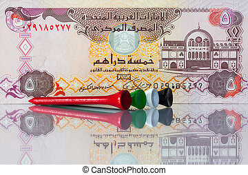 Money and golf equipments in UAE  national colours