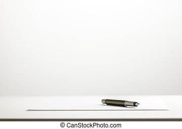 Pen on a sheet of blank white paper - Low angle view of a...