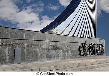 Detail from the titanium obelisk representing the Soviet succes dream, featuring scientists and engineers hard at work. Monument of Sovjet space flight, near VDNK exhibition center, Moscow, Russia