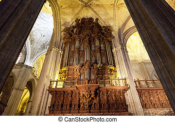Ancient pipe organ in a cathedral in Seville, Spain