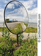 Round mirror on a pole by the road - A saftey mirror...