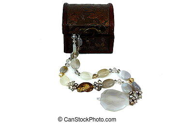 Beads near the casket - On a white background a dark box,...