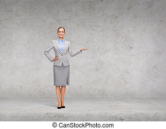 businesswoman showing something on her hand - business and...