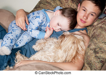 Young uncle - A teenage boy holds his sleeping nephew.