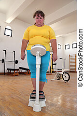 overweight on scales in gym
