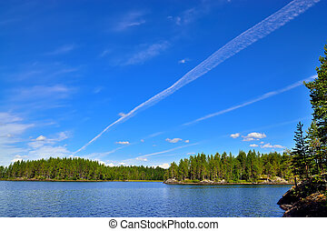 Karelian landscape and the trace of the plane. Lake...