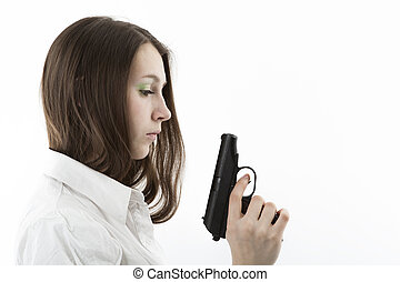 young girl holding a pistol isolated on a white background