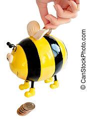bee moneybox - photo of the isolated on white bee moneybox...