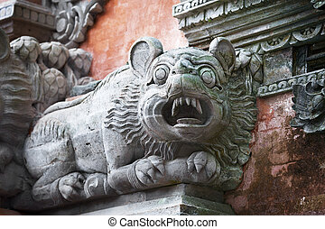 Animal like a dog on the wall of temple Bali, Indonesia -...
