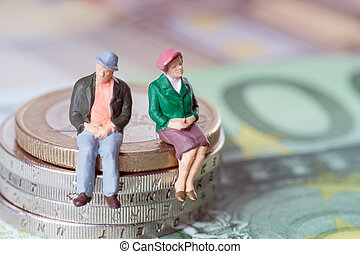 Old couple - Grandma and Grandpa on a stack of euro coins