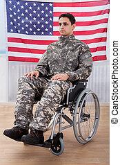 Patriotic Soldier Sitting On Wheel Chair Against American...
