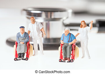 wheelchair user with nursing staff and stethoscope over a...