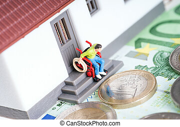 Wheelchair user on an exterior staircase and euro money