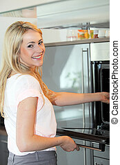 Beautiful woman cooking in her kitchen