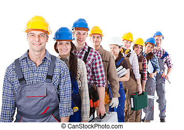 Large group of construction workers queuing up - Large group...