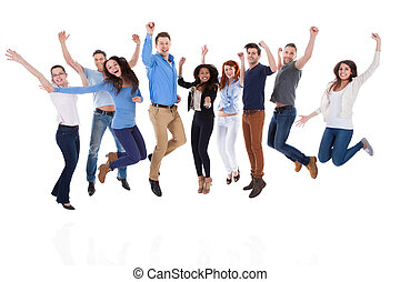 Group of diverse people raising arms and jumping. Isolated...