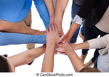 Group of people stacking hands together Isolated on white