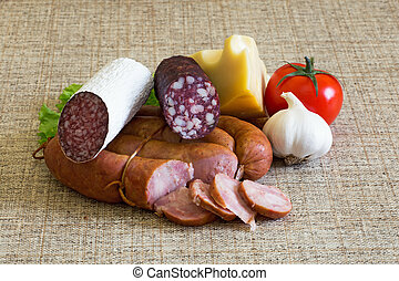 Smoked sausage with rustic food, vegetables and cheese