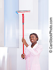 Housekeeper Cleaning Glass In Hotel - Smiling African...