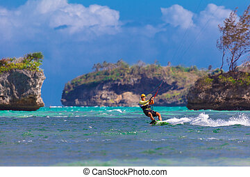 young kitesurfer on sea background Extreme Sport Kitesurfing...