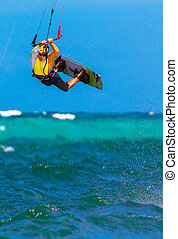 young smiing kitesurfer on tropical sea background Extreme...