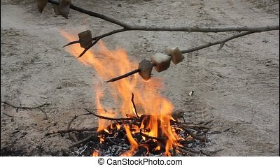Toasting fat on the fire - During the tourist walks can fry...