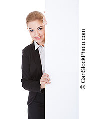 Businesswoman Holding Placard - Smiling Businesswoman...
