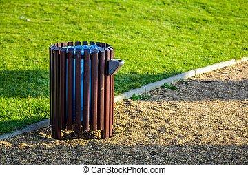 Bin in park - Wooden bin in green park