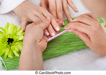Beautician Filing Nails Of Woman - Close-up Of Beautician...