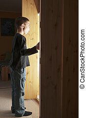Light coming out from cupboard - Boy opening a cupboard and...